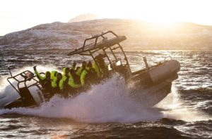milpro zodiac riverine SRA 750 cruising in the arctic sea norway with happy guests onboard